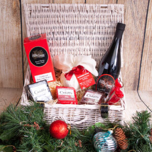 wicker christmas hamper with choice of cheese crackers port glasses and christmas pudding